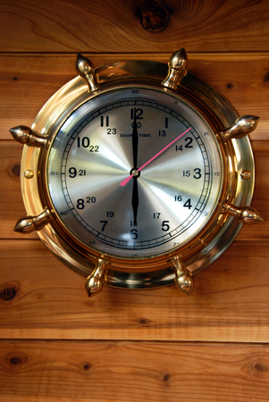planking: Close Up of Brass Ships Clock Against Red Cedar Planking, 6 OClock, 18 Hundred Hours