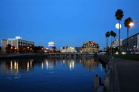 Downtown Stockton City Skyline Reflected in Water at Early Evening, California Stock Photo