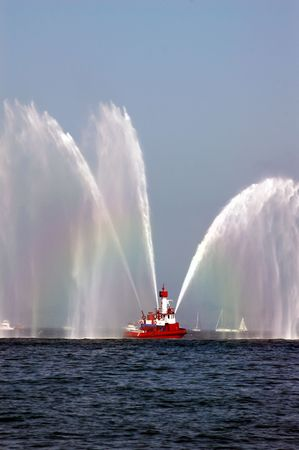 Red Fireboat Spraying Rainbow Streams of Water
