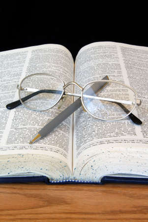 Open Dictionary with Pen and Glasses