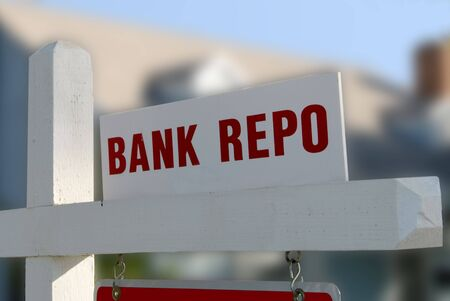 repossession: Bank Repo Notice on  For Sale Real Estate Sign Stock Photo