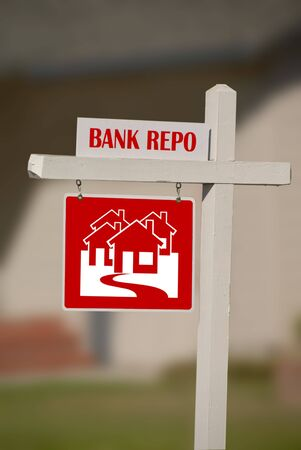 Bank Repo Notice on  For Sale Real Estate Sign Stock Photo