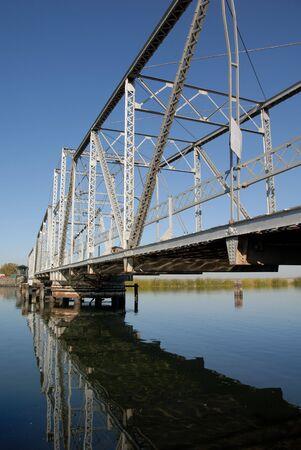 california delta: Reflection of Pivoting Steel Levy Bridge, San Joaquin Delta Agricultural Area, California