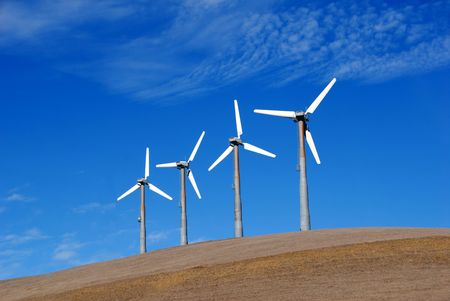 Stark White Electrical Power Generating Wind Turbines on Rolling Hills, Altamont Pass,  California photo