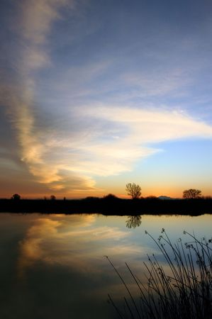 cloud formation: Butterfly Shapped Cloud Formation Reflected In Quiet Wildlife Pond