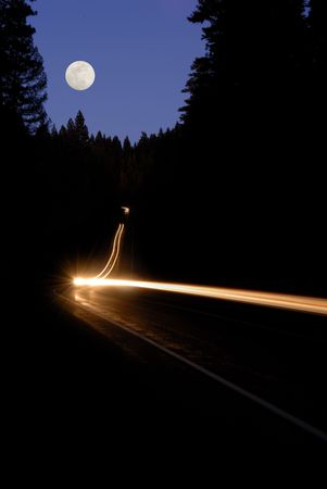 Forest Highway at Dusk With Light Blurs And Full Moon Stock Photo - 2274414