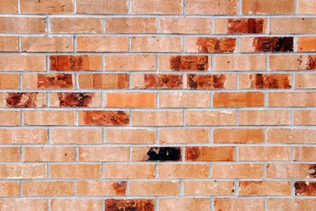 Staggered Colored Red Bricks Forming a Patterned Background Stock Photo - 2274458