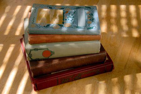 bind: 100 Year Old Books Under Dramitic Light Stock Photo