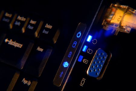 Tight Closeup of Laptop Input And Output Connectors With Abstract Blue Lens Flare Stock Photo