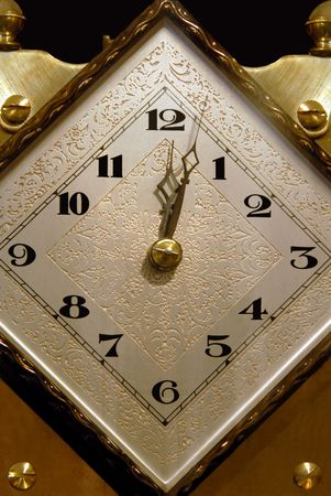 Close up of ornate brass clock face, at twelve o' five. Imagens - 2423031
