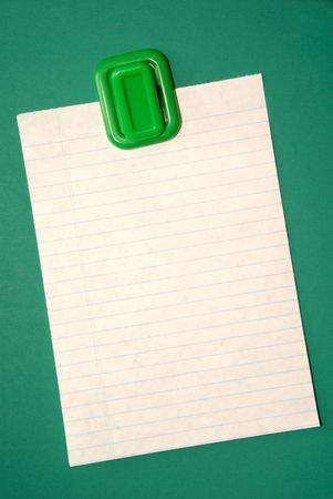 Blank white note paper hanging from magnetic pinup on green background.. Stock Photo - 2523129