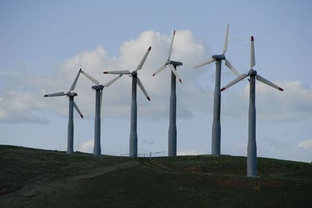 energies: Silhouettes of Electrical Power Generating Wind Turbines on Rolling Hills, Altamont Pass,  California