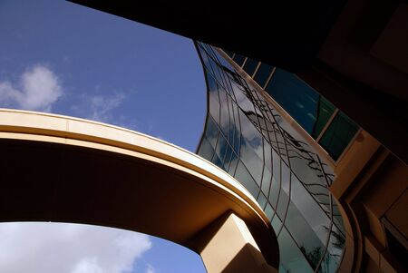 office building exterior: Abstract Cloud Reflection and Curved Office Building Exterior