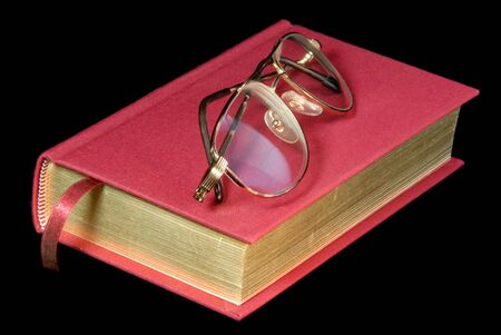 reading material: Colorful Red Book And Reading  Glasses