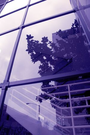office building exterior: Abstract Blue Toned Reflection of Office Building Exterior Stock Photo