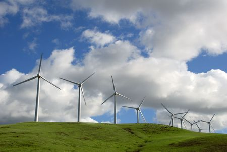 altamont pass: White Electrical Power Generating Wind Turbines on Green Rolling Hills, Altamont Pass,  California Stock Photo