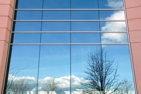 office building exterior: Reflection on Glass of Office Building Exterior Stock Photo