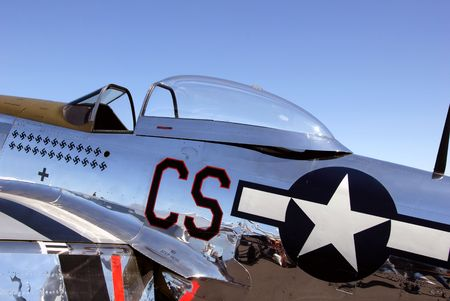 Polished aluminum P 51 Mustang, top fighter aircraft of World War II (editorial).