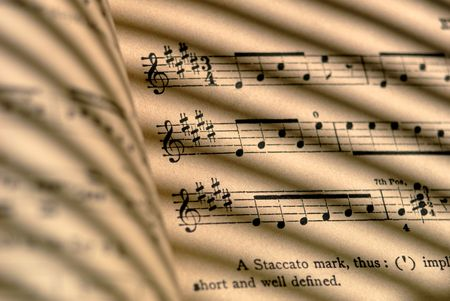 Detail of 100 year old grungy sheet music. Banco de Imagens