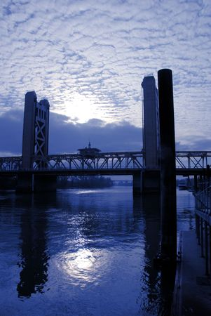 Sunset and Weathered Sky over Tower Bridge In Sacramento California