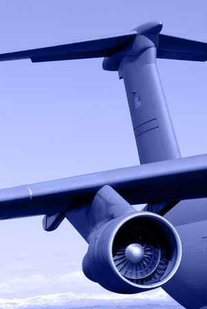 Blue Toned View of Tail, Wing, Engine, of an Ageing Galaxy C-5 U.S. Military Transport Aircraft Stock Photo - 3398993