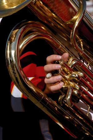 school band: Youthful High School Marching Band Member with Aged Brass Euphonium in Hand