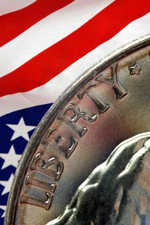 Red, White, and Blue From American Flag Reflected in Liberty Motto on Vintage, Retro, 1967 United States Nickel Stock Photo