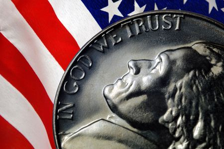 Red, White, and Blue From American Flag Reflected in God We Trust Motto on Vintage, Retro, 1967 United States Nickel Standard-Bild