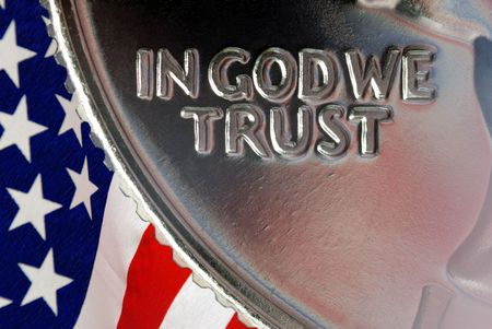 silver coins: Red, White, and Blue From American Flag Reflected in God We Trust Motto on Vintage, Retro, 1967 United States Quarter Stock Photo
