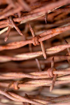 Macro of Rusty Barbed Wire Coil photo
