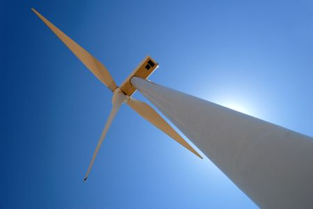 Power generating wind turbine against sun and blue sky, Rio Vista California. Stock Photo