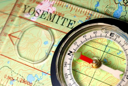 topographical: Transparent Navigational Compass on Topographical Map of Yosemite National Park, Needle Pointing Dead North Stock Photo