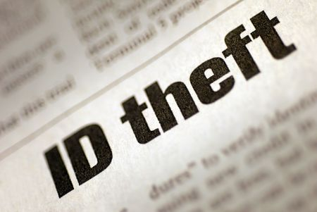 internet fraud: Black and White Newspaper Headline stating Identity Theft Stock Photo