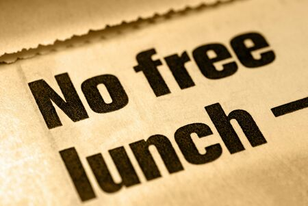 Selective Focus Macro of No Free Lunch News Headline Banco de Imagens