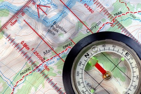 Transparent Navigational Compass on Topographical Map of Pacific Crest Trail, Needle Pointing to Magnetic North photo