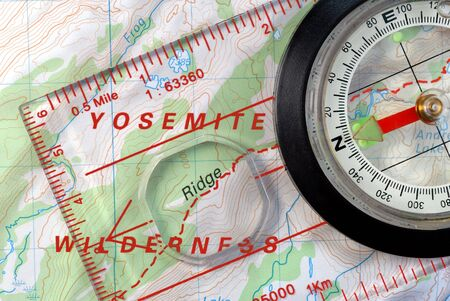 magnetic north: Transparent Navigational Compass on Topographical Map of Yosemite Park, Needle Pointing to Magnetic North