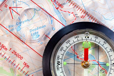 magnetic north: Transparent Navigational Compass on Topographical Map, Needle Pointing to Magnetic North