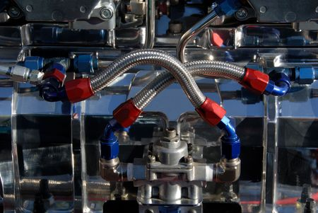aluminum rod: Carburators and Fuel Lines on an American Hot Rod engine.