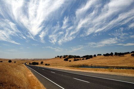 country highway: Country Highway under Summer Skies Stock Photo