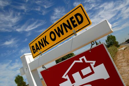 bank owned: For Sale Real Estate Sign With Bank Owned Notice Stock Photo