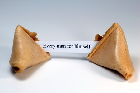 darwinism: Fortune cookie with the expression: every man for himself! Stock Photo