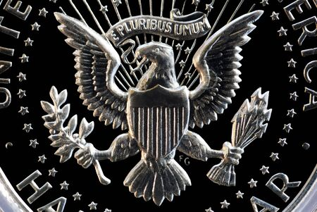pluribus: Extreme closeup of eagle and e pluribus unum motto on the back of a US Silver Half Dollar