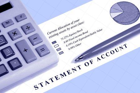 Asset statement, declining graph line, calculator, and pen. Stock fotó
