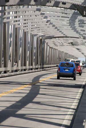 girders: Traffic on rural bridge with steel girders, Sacramento, California.