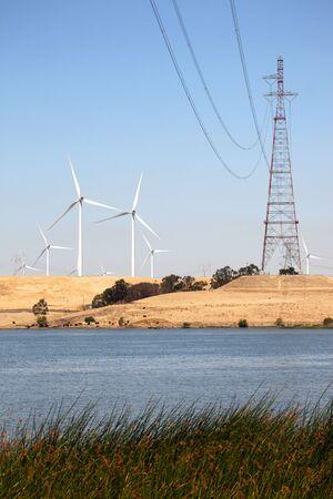 Wind turbines and power lines over Sacramento River, California Imagens