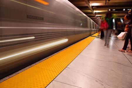 Subway platform in blue, motion blurred people, Embarcadero Station, San Francisco, California. photo