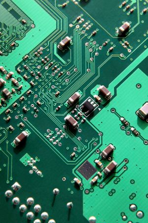 Macro of printed circuit board patterns and electronic parts, selective focus according to rule of thirds.