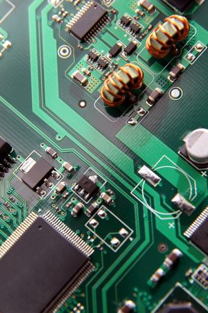 Macro of printed circuit board patterns and electronic parts, shallow depth of field, focus on circuit pattern at center.. Banco de Imagens