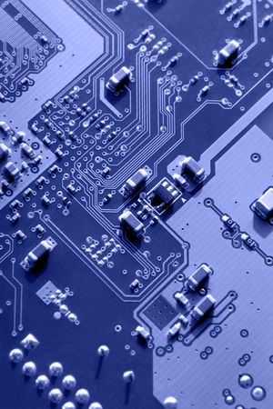 rule of thirds: Blue macro of printed circuit board patterns and electronic parts, selective focus according to rule of thirds. Stock Photo