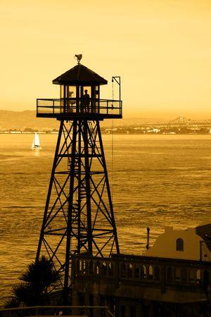 Silhouette of Alcatraz Guard Tower, Bay Bridge in background. Stock Photo - 6731785